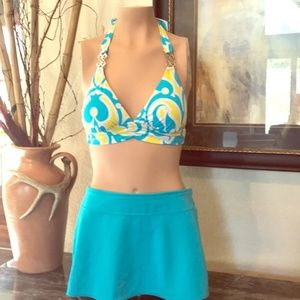 2 Bikini tops with skirted bottom bathing suits.